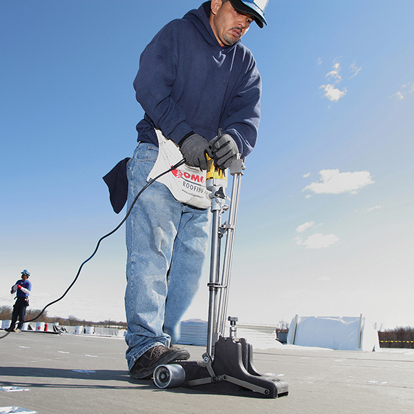 Image of man using AccuTrac on Staples roof