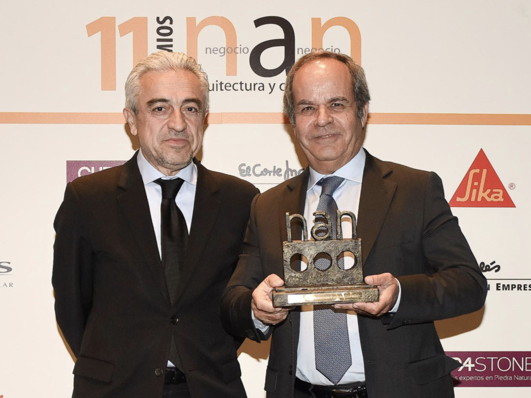 Image of 2 men holding an award