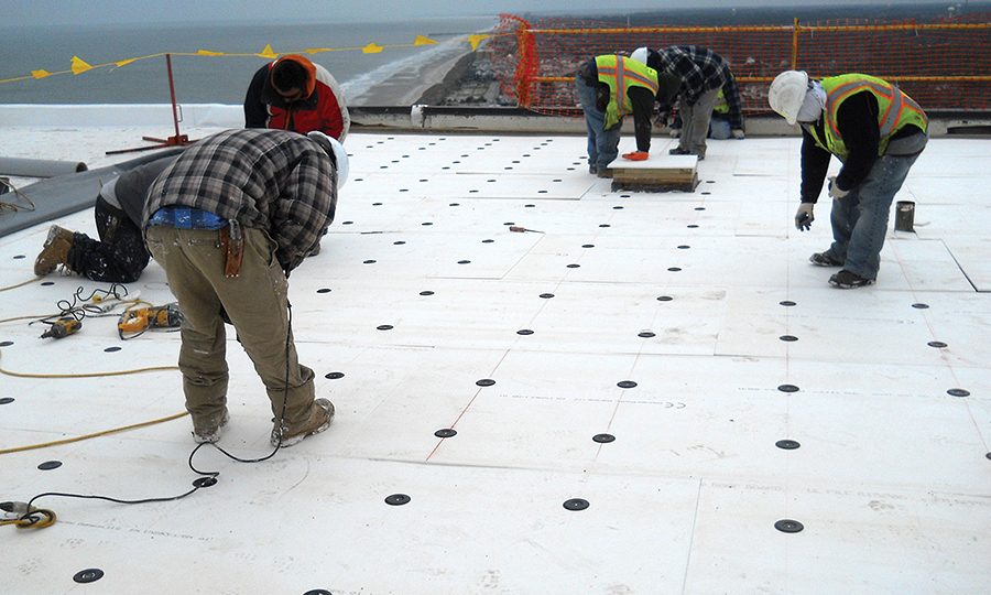 Image of workers on roof