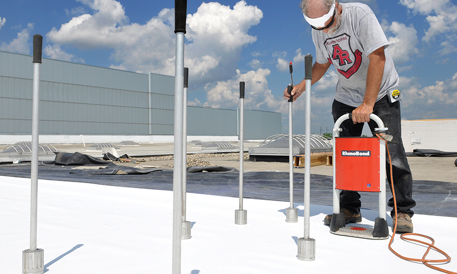 Image of worker using OMG roofing product