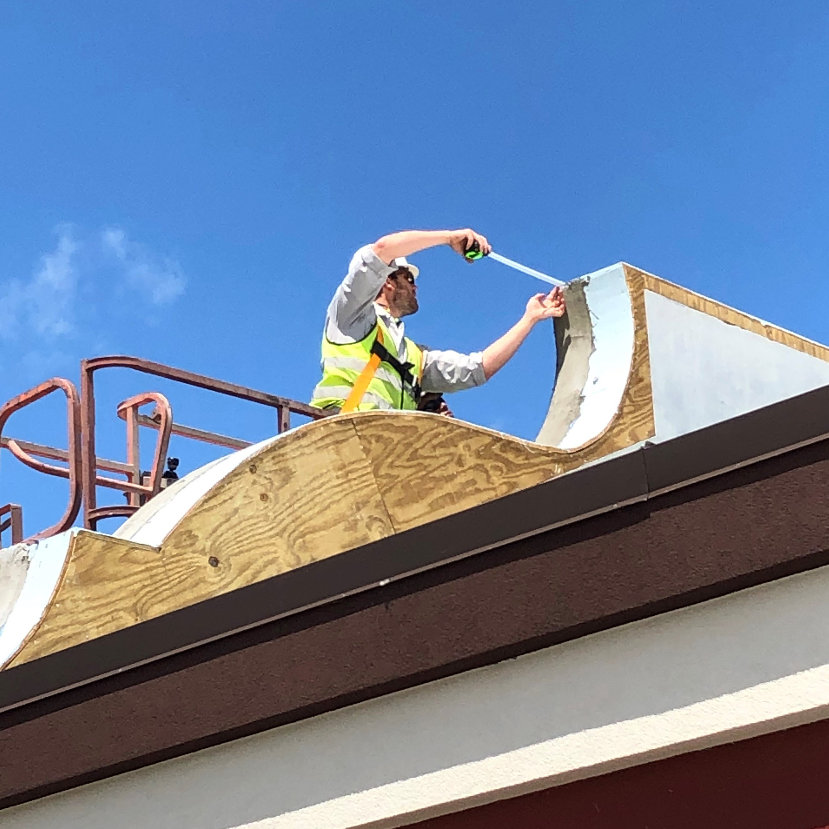 Man measuring roof